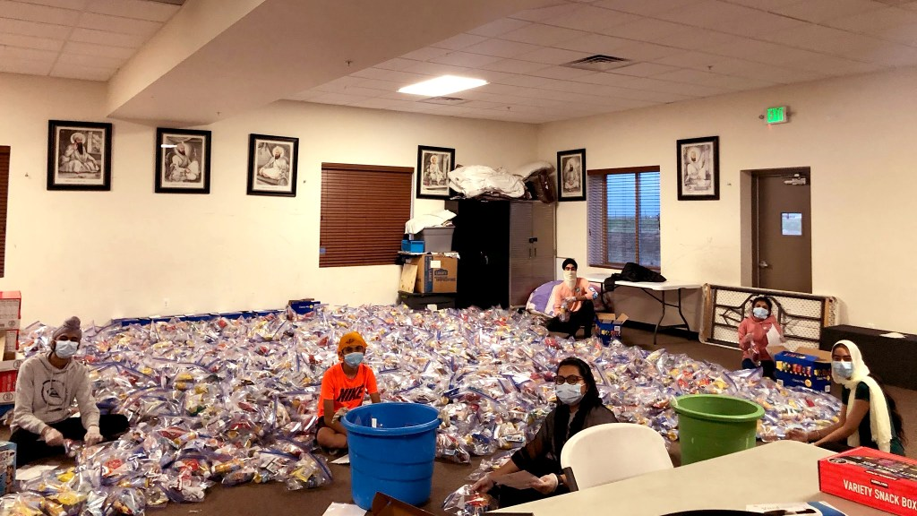 Kids at Colorado Singh Sabha in Commerce City pack thousands of bags of snacks into boxes bound for frontline workers around the state. May 8, 2020. (Courtesy: Anmol Singh)