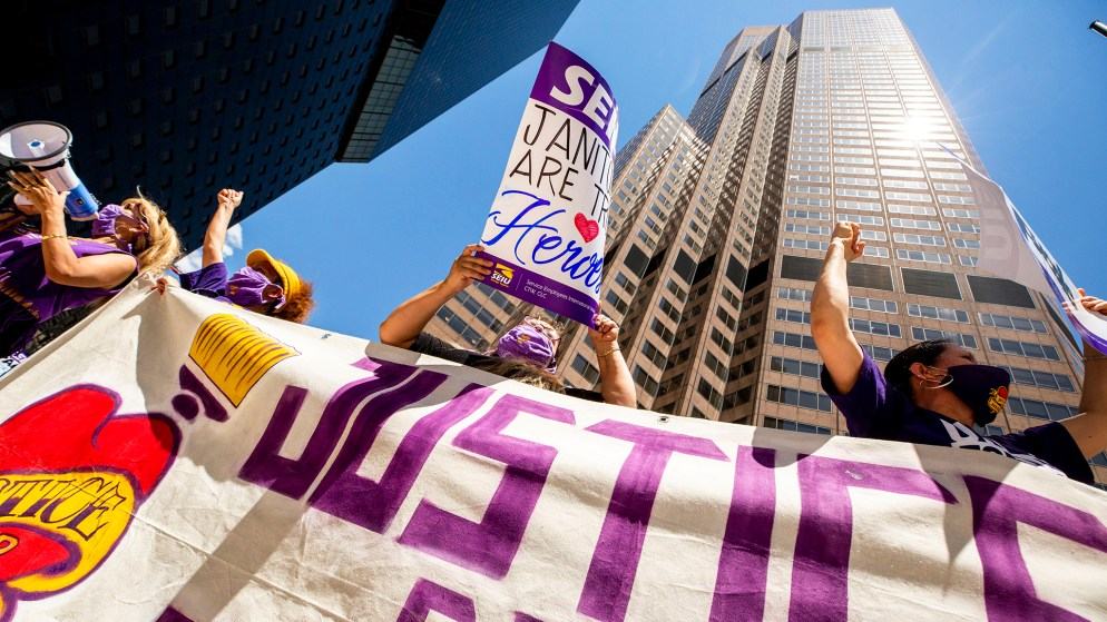 Jennifer Menjivar (left to right), Madeline Astudillo, Maria Nieto and Eva Martinez protests with other Service Employees International Union janitors for better safety measures and higher wages outside of 1801 California Street downtown. May 19, 2020. (Kevin J. Beaty/Denverite)