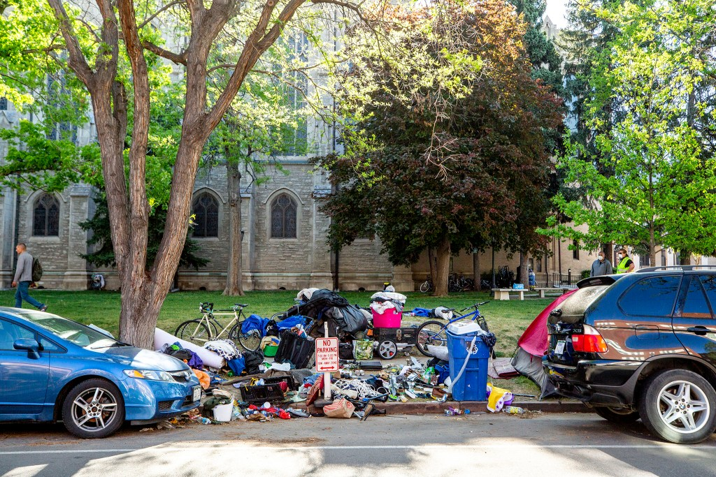 Items belonging to people who have been living outside of St. John's Episcopal Cathedral in Capitol Hill. May 20, 2020. (Kevin J. Beaty/Denverite)