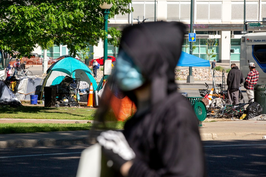 Denver Democratic Socialists, dressed as grim reapers, protest a lack of eviction protections in front of the Capitol as people sleep in tents nearby. May 26, 2020. (Kevin J. Beaty/Denverite)