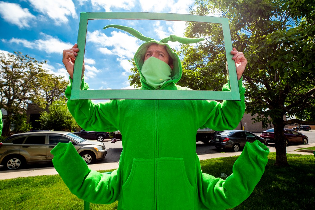 """Brian Colonna participates in a """"Zoom meeting"""" for the Buntport Theater's The Grasshoppers, a play you can watch from your car. May 28, 2020. (Kevin J. Beaty/Denverite)"""