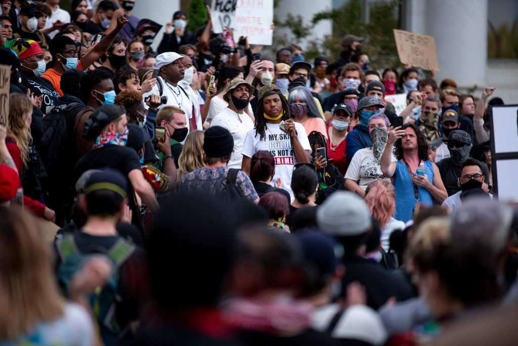 Quincy Shannon leafs chants during a rally in reaction to the killing of George Floyd. He and other protest leaders tried to push a message of nonviolence. May 29, 2020. (Kevin J. Beaty/Denverite)
