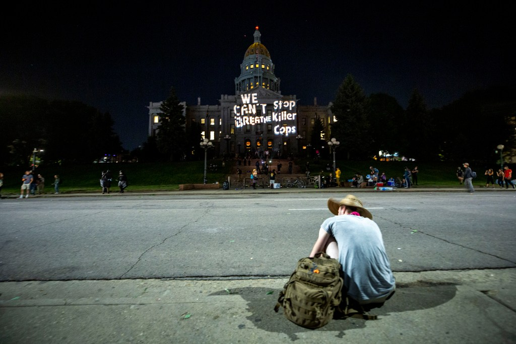 "The Capitol is emblazoned with ""We can't breathe. Stop killer cops,"" as protests against police brutality continued on Saturday, June 7, 2020. (Kevin J. Beaty/Denverite)"