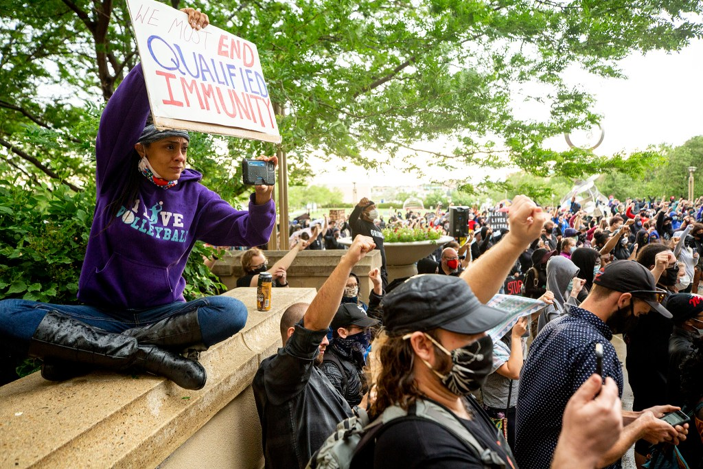 Elisabeth Epps (left) livestreams a rally in memory of Elijah McClain, who died after an interaction with Aurora police in 2019. June 6, 2020. (Kevin J. Beaty/Denverite)
