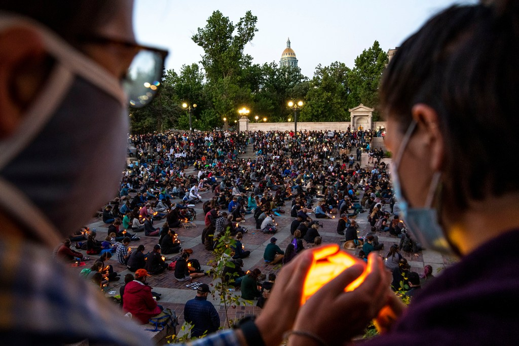 A vigil for George Floyd at Civic Center Park on the day of his burial. June 9, 2020. (Kevin J. Beaty/Denverite)