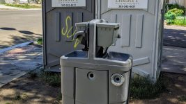 Portable toilets and a public hand-washing station at Sonny Lawson Park in Five Points on June 26, 2020. (Donna Bryson/Denverite)