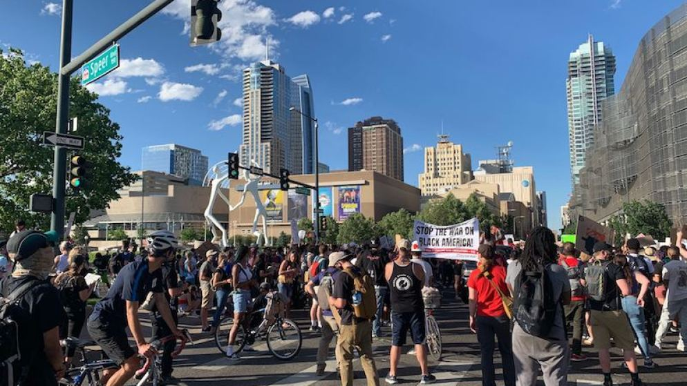 A march organized by the Party for Socialism and Liberation stops on Speer Boulevard on Sunday, June 7, 2020, in Denver. (Esteban L. Hernandez/Denverite)