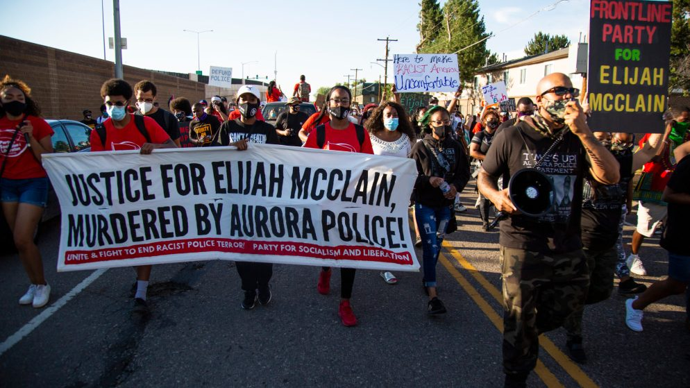 Demonstrators calling for justice for Elijah McClain march through Aurora on the evening of July 3, 2020.
