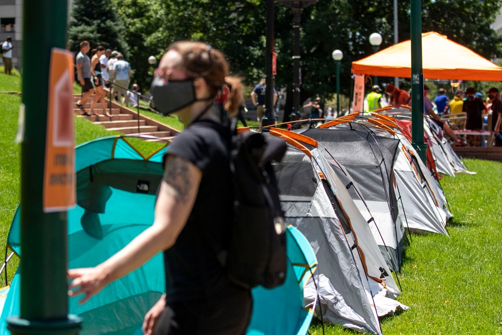 The Denver Democratic Socialists of America stage tents in front of the Capitol to protest rent and evictions as the economy continues to struggle under the pandemic. July 1, 2020. (Kevin J. Beaty/Denverite)