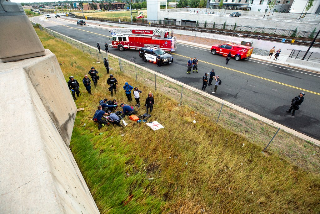 Emergency response vehicles on I-225 in Aurora after a driver sped into protesters on July 25, 2020. The woman below fell from the highway soon after the driver passed and a protester began firing a gun.