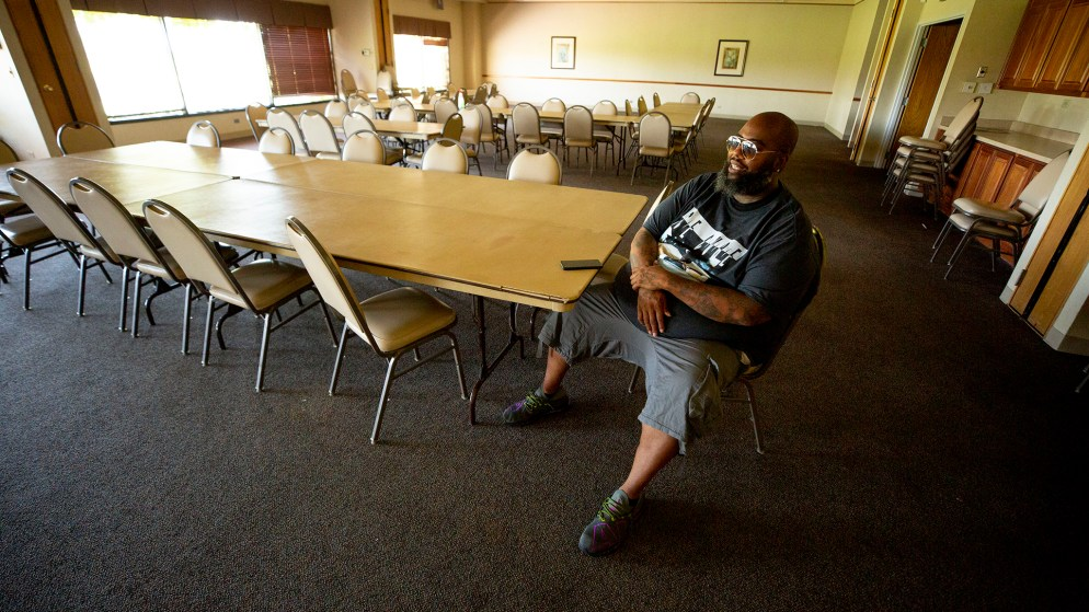 Jason McBride sits inside the Park Hill Golf Course clubhouse, which he'll transform into a safe learning space for remote schooling and more. Aug. 7, 2020.