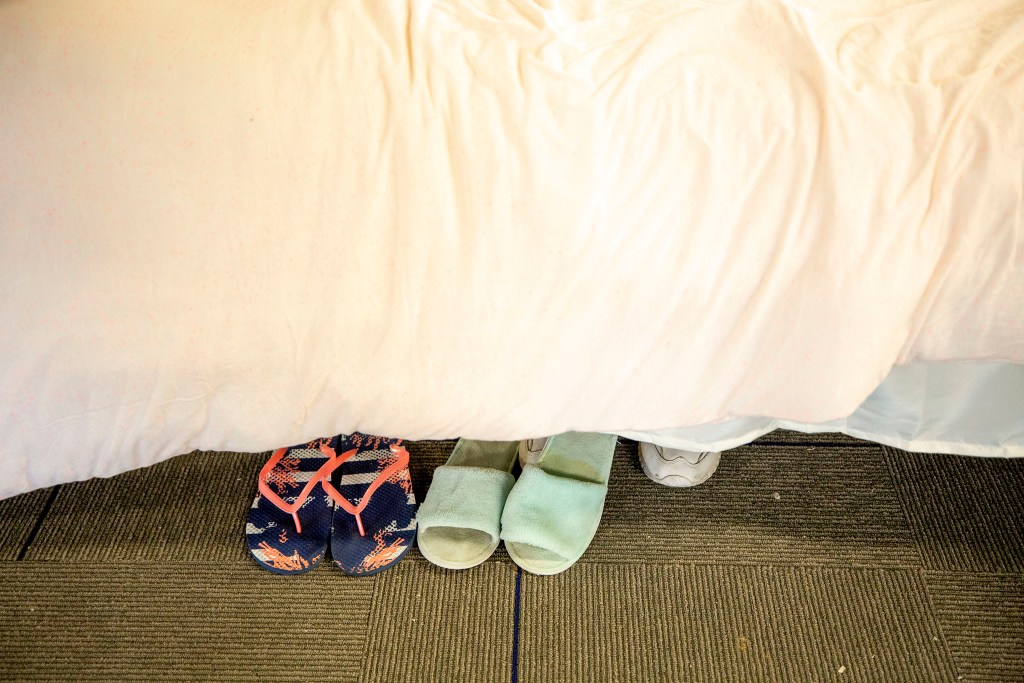 Slippers under a bed in Sinton's Sanctuary, the shelter for senior women at the Volunteers of America building on Santa Fe Drive in Denver's Lincoln Park neighborhood. Aug. 14, 2020.