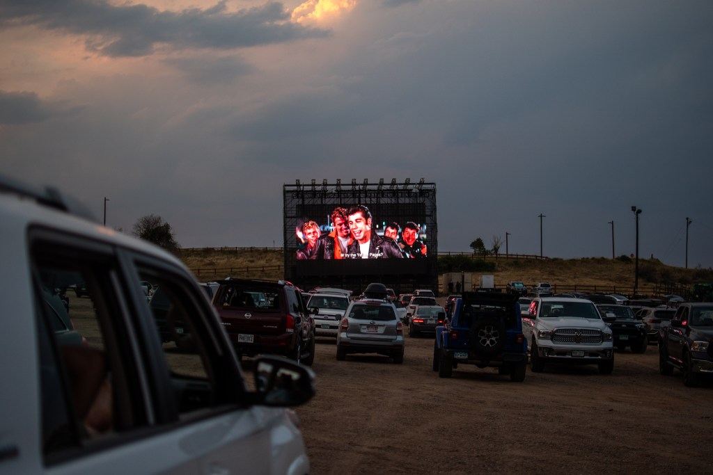 Grease plays on the 47-foot-wide LED screen as the debut film screening of the 21st annual Film on the Rocks, drive-in edition at Red Rocks Park on Aug. 13, 2020.