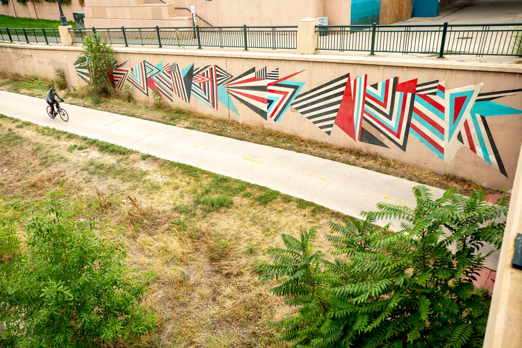 A mural by Bruno Nevelli at Little Raven Street along the Cherry Creek Trail. Sept. 10, 2020.