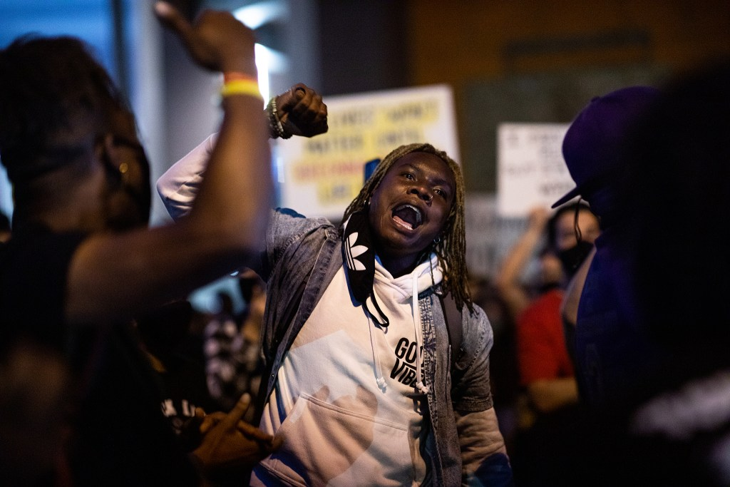 "A man yells, ""Breonna Taylor"" on Sept. 23 in a Denver march during a rally for Breonna Taylor after a grand jury announced charges against one of the officers involved in her shooting death."