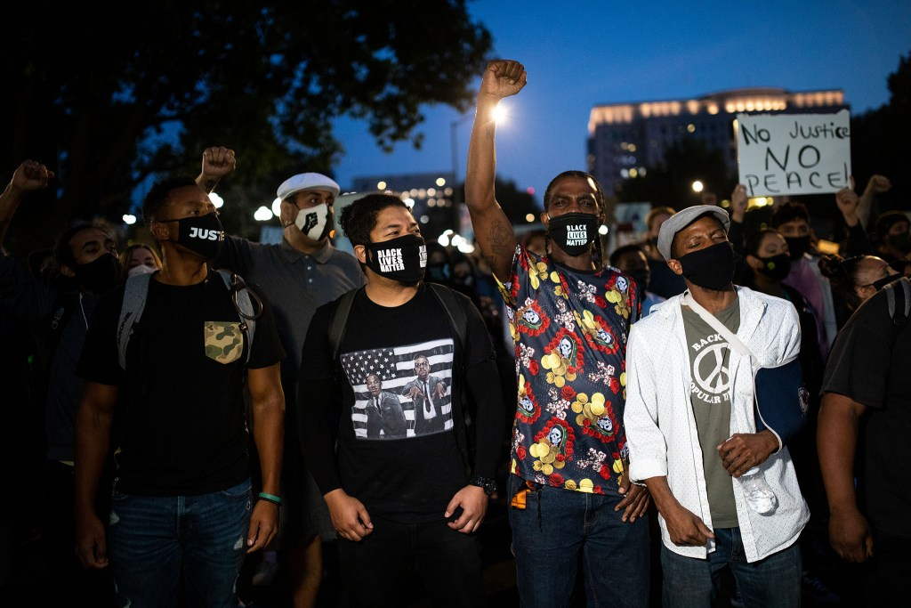 Hundreds of demonstrators march in Denver on Sept. 23 during a rally for Breonna Taylor after a grand jury announced charges against one of the officers involved in her shooting death.
