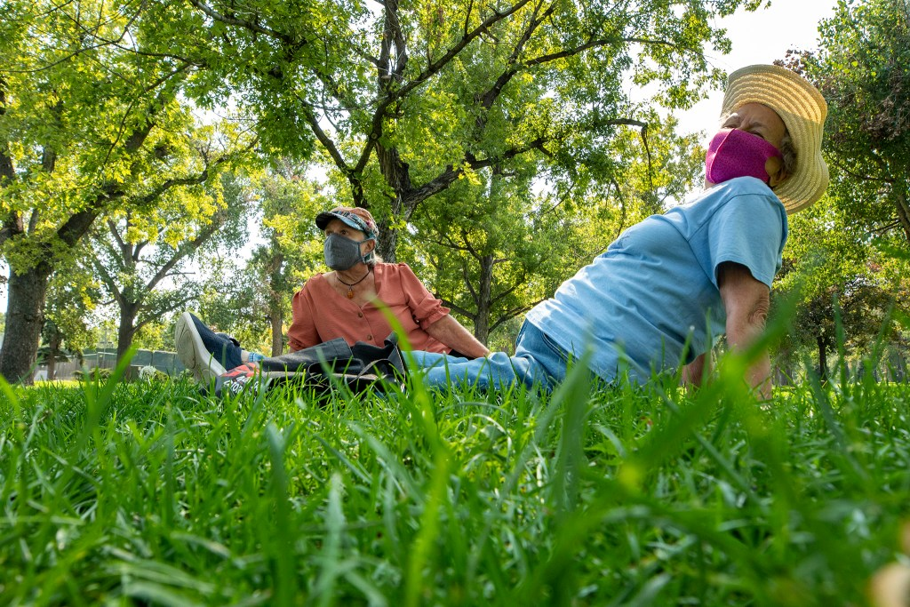 Kate Lutz and Susana Anderson lunch in the grass at City Park. Sept. 24, 2020.