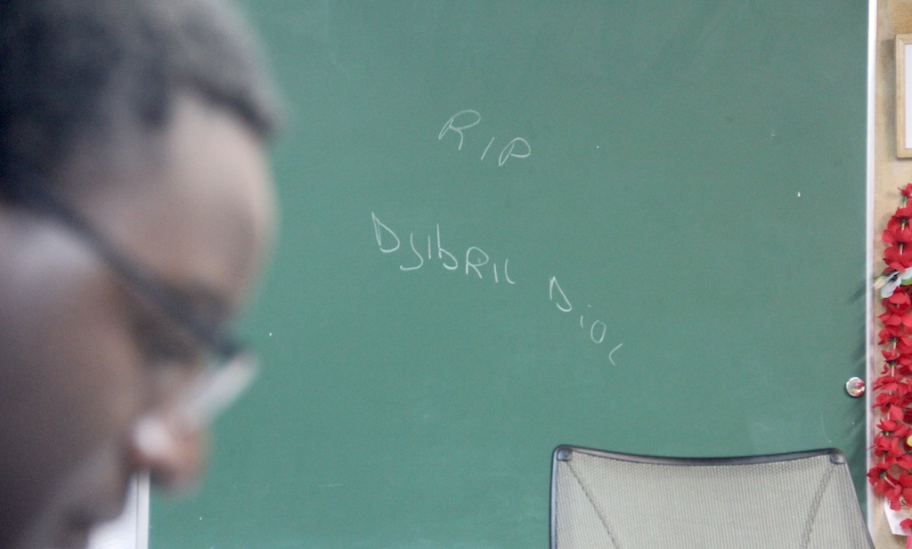 A chalk scrawling commemorating Djibril Diol, who was killed in a fire in Green Valley Ranch, inside Amadou Dieng's office at the African Leadership Group on Wednesday, Sept. 30, 2020, in Aurora. (Esteban L. Hernandez/Denverite)