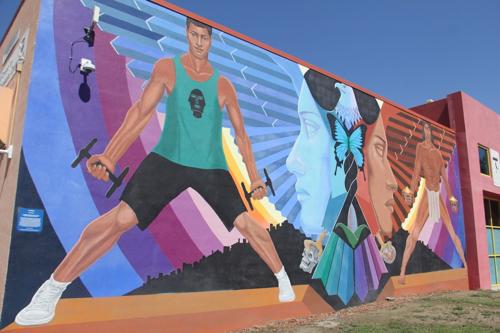 """La Alma"" mural on the walls of the La Alma Recreation Center on Sept. 1, 2020, in the Lincoln Park neighborhood in Denver. (Esteban L. Hernandez/Denverite)"