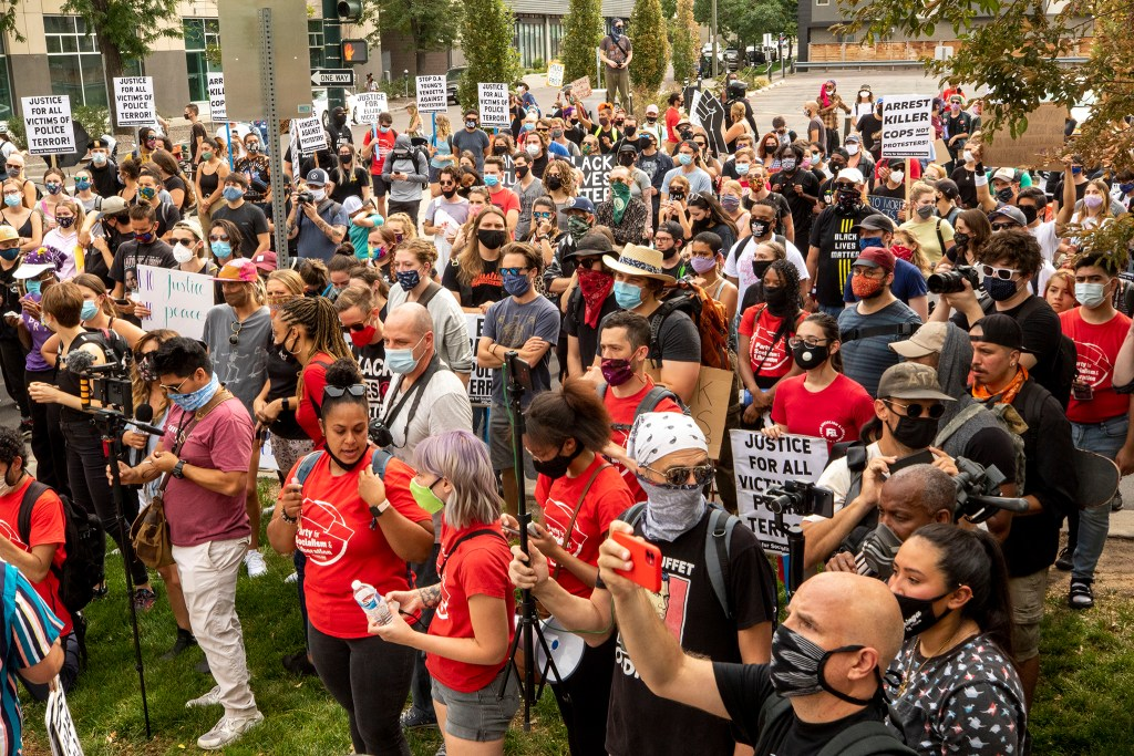 Protesters gathered outside of Denver's downtown jail after Shawn McWilliams was taken into custory for an oversized magazine – a ticketable offense. Sept. 26, 2020.
