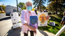 Barbara Methvin made off with two books from the Denver Public Library's mobile bookmobile parked at Clermont Park in University Hills. Oct. 13, 2020.