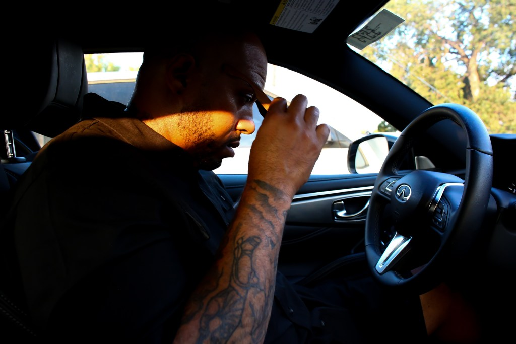 Terrance Roberts gets in his car to go meet with members of the activist group he co-founded, Frontline Party for Revolutionary Action to plan their next protest in Denver, August 5, 2020. (Kevin Mohatt/For CPR News)