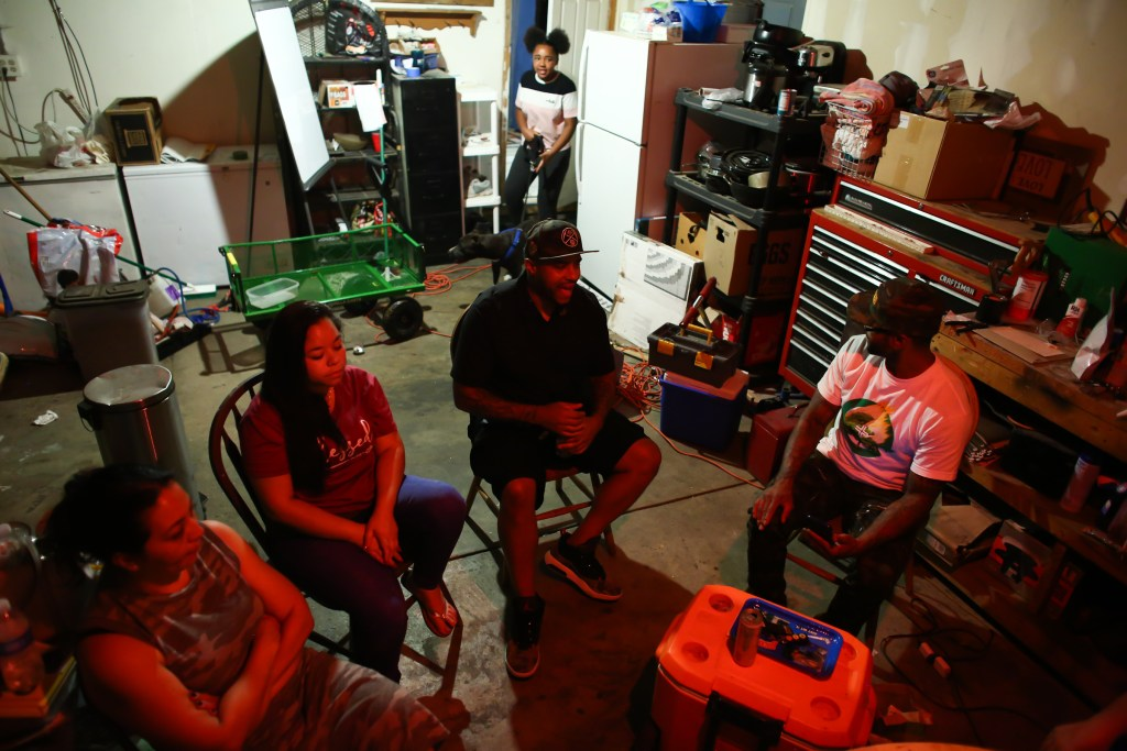 Terrance Roberts meets with members of the activist group Frontline Party for Revolutionary Action at Candice Bailey's home in Aurora to plan their next protest against police violence, August 5, 2020.