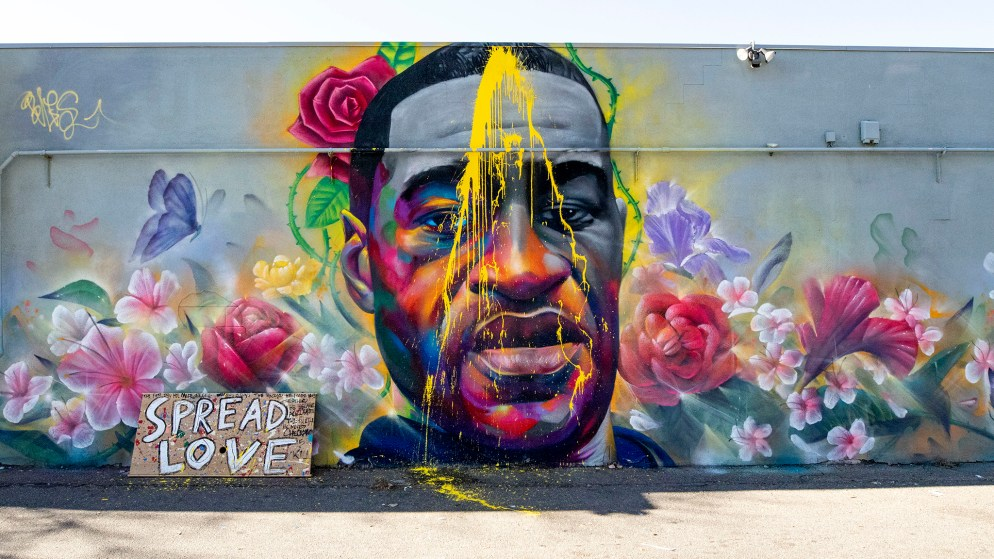 Detour and Heiro's mural of George Floyd, on East Colfax Avenue, was defaced for the second time in a month. Nov. 4, 2020.
