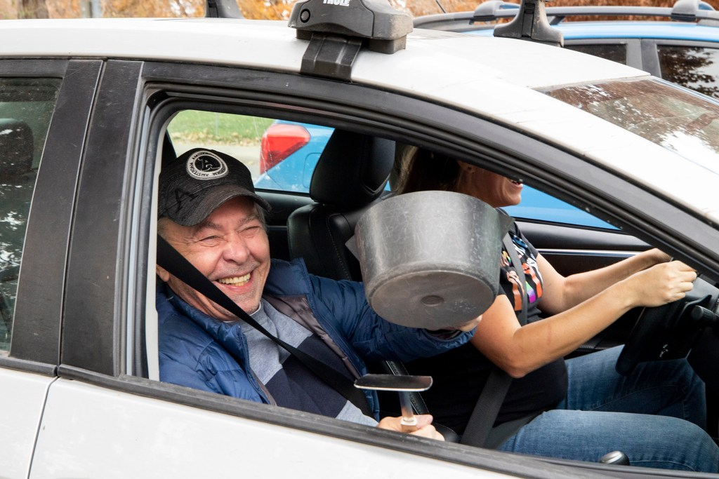 Bill Huston banged together a pot and a spatula on his drive around Denver celebrating Joe Biden's victory in the U.S. presidential election. Nov. 7, 2020.