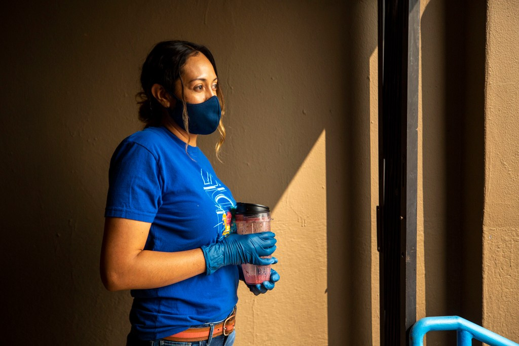 Maria Saucedo volunteers at a food pantry set up outside Wyatt Academy in Cole. Sept. 16, 2020.