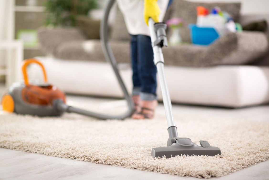 bigstock-Close-up-of-vacuuming-carpet-w-120760328