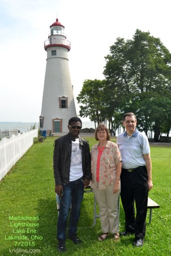 Friends in front of a beautiful Lake Erie lighthouse