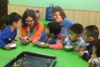 Vivian meets some of the hearing-impaired children that JHF helps through a special training program.
