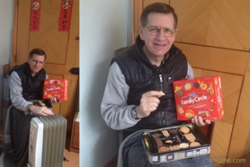 The upcoming Chinese New Year means cookies are on sale (with lots of other edible gifts). Vivian caught me warming my hands over the radiator, and checking out my new treasure.