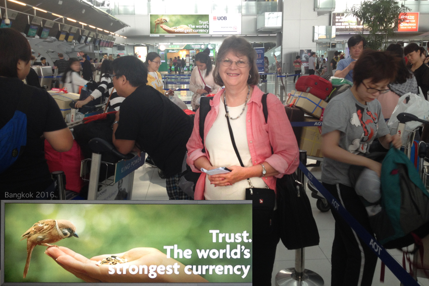 Finally, in the Bangkok airport: more lines and waiting. And the Hong Kong airline actually weighs your carry-on luggage! Leaving HK, we had to check Vivian's carry-on, and put some of my electronics in a bag for her to carry on board. We packed differently for the return. I also loved this bank poster (in the background and repeated larger). TRUST is the world's strongest currency!