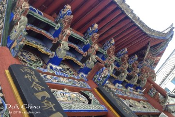 """We read that much thought went into giving this church a """"feel"""" that would mesh with the local Bai minority culture. The traditional carvings and colors were very striking."""