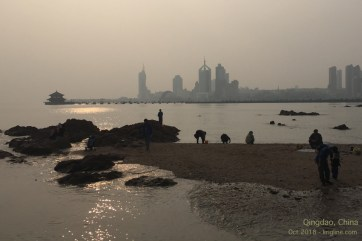"""Qingdao is famous for seaside sports (including Olympic yachts in 2008), and for """"Tsingtao"""" beer (whose logo features the pagoda at the end of this pier)."""