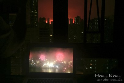 "Finally, it is hard to give you a good idea of what we can see from our window, but this shot comes close. The smaller screen is my computer, on which we are watching the Fireworks live via webcam! See the top of my ""links"" page for this cool website."
