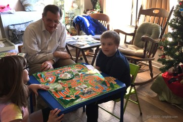 Here's Grandpa playing a board game (Life) with Christy and CJ.