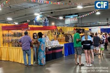 Festival guests shop at the International Bazaar