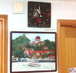 These were the first wall decorations we put up in HK. One of Vivian's Xiamen students painted the picture, and the clock features one of our son's illustrations!