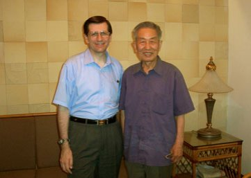 Artist Mr. Niu with Michael in Xi'an. He was 84 in 2005 when he painted the DaQin tower for me.