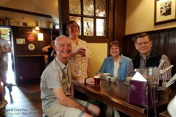 """Here we are with the Wernhams inside the pub, affectionately known by locals as """"the Bird and Baby."""" We enjoyed a cup of tea and """"chips"""" in the very room where these literary greats once met, as memorialized by many photos and memorabilia on the walls."""