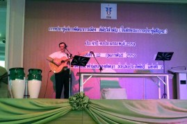 "I also got to sing and speak a few other times during the conference. I have no idea what the Thai writing behind me says! It is frustrating being in a place where you can't talk to people. And of course, we all default to Chinese when around Asians, but it is as foreign to them as we are! ""Stick to English, please."""