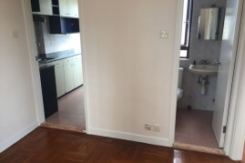 """You can only """"back up"""" so far in 310ft apartment (on the 22nd floor), so getting good photos is difficult, but here you see the kitchen and bathroom from the sitting room."""