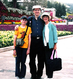 "Vivian, Michael and Andrew stand in front of a floral ship, ""sailing"" on a sea of flowers (2006)."