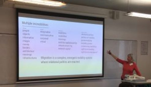 Monika Buscher presenting the multiple mobilities involved in healthcare and migration. It says 'migration is a complex emergent mobility system where relational politics are enacted'
