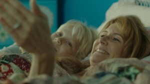 Laura Dern, as Strayed's mother Bobbi, in a flashback with a younger Cheryl