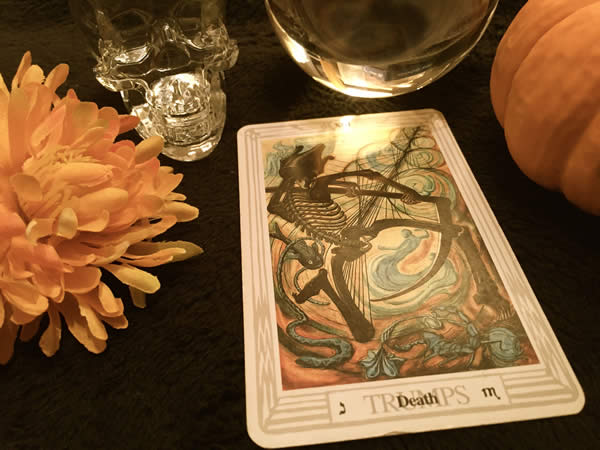"""a tarot card featuring a dancing skeleton labeled """"Death"""""""