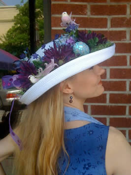 a woman in a fancy hat